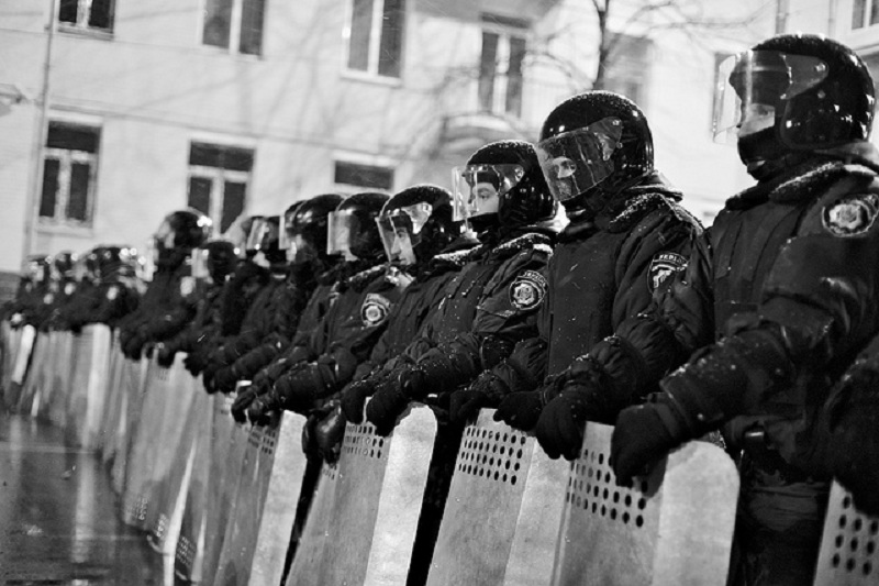 Image Source: Ivan Bandura, Flickr, Creative Commons Riot police blocking the way to the parliament building on Sunday night The March of Millions on Sunday the 8th of December in Kiev