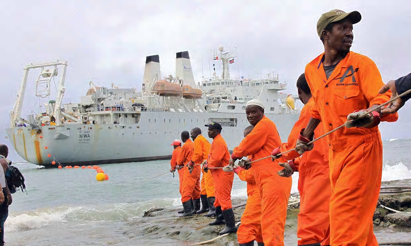 Workers haul part of a fibre optic cable on to the shore at Mombasa, Kenya. 'Research suggests many African countries are well placed to take advantage of a more open trading environment.' Photograph: AFP/Getty Images
