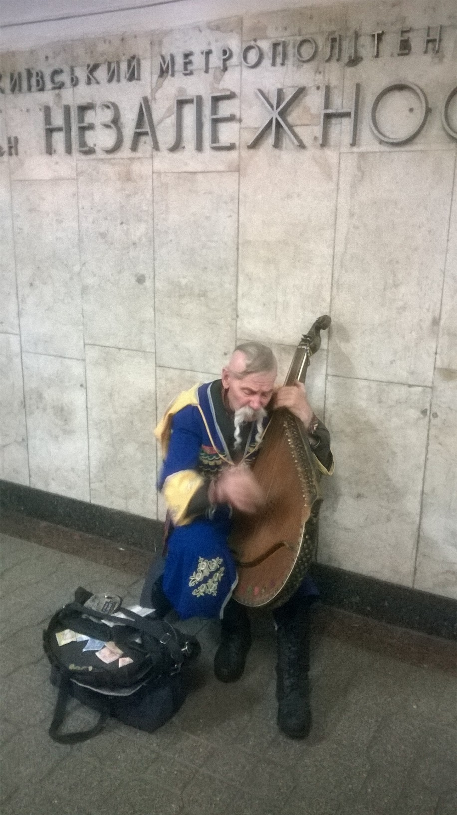 Ukrainian cossac playing bandura to earn for his life